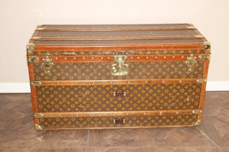 This magnificent Louis Vuitton shoe trunk features stenciled canvas monogram, Louis Vuitton stamped solid brass locks, studs and side handles. It also has got honey lozine trim. Painted customized stripes on its sides. It has got a beautiful and
