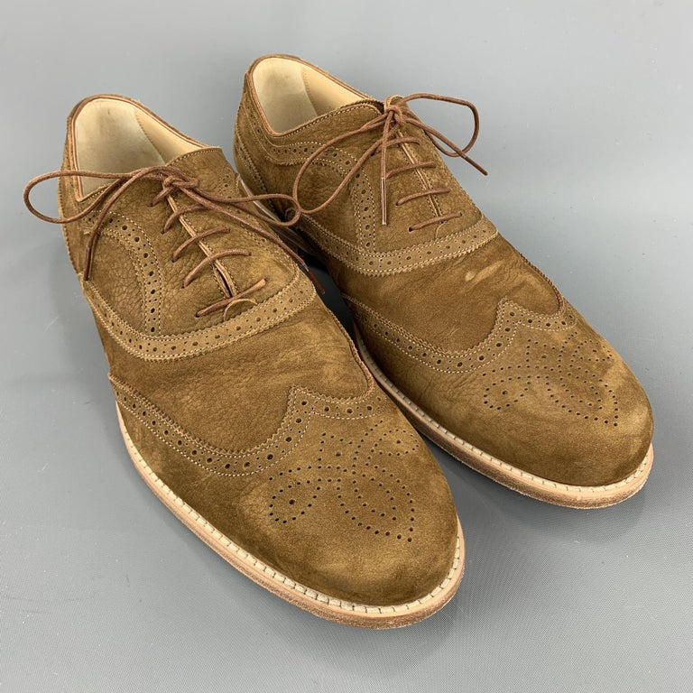 Men's LOUIS VUITTON lace up shoes comes in a brown perforated leather featuring a cap toe and a wooden heel. Made in Italy.  Excellent Pre-Owned Condition. Marked: 10.5  Outsole: 4.25 in. x 12.5 in.