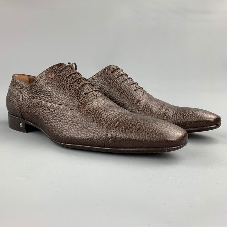 LOUIS VUITTON lace up shoes comes in a brown textured leather featuring a cap toe, top stitching, silver tone hardware, and a wooden sole. Made in Italy.  Very Good Pre-Owned Condition. Marked: ST1110 / 11  Outsole:  12.5 in. x 4 in.