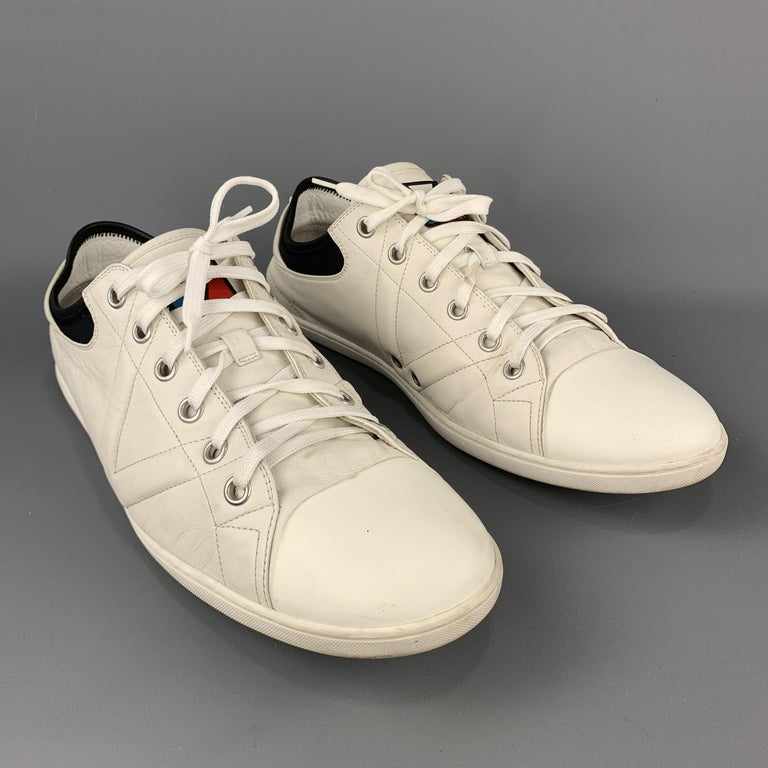 LOUIS VUITTON Sneakers comes in an off-white tone in a solid smooth leather material, with a low top, a black trim, a rubber cap toe, a rubber sole, lace up. As is. Made in Italy.  Good Pre-Owned Condition. Marked: 12   MS 0195  Outsole: 4.2 x 13 in.
