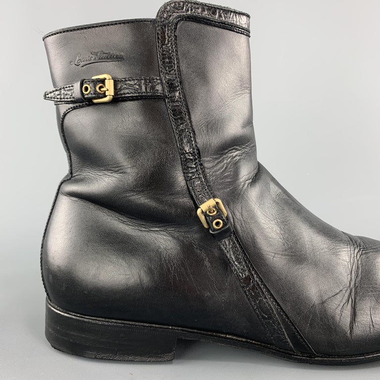 LOUIS VUITTON zip ankle boots come in smooth black leather with a squared off toe, embossed logo, and crocodile embossed patent leather piping with gold tone buckled belt details. Wear on toes. Made in Italy.  Good Pre-Owned Condition. Marked: UK