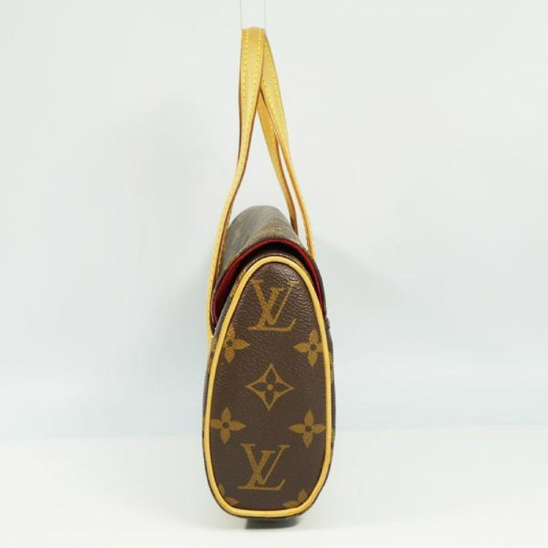 An authentic LOUIS VUITTON Sonatine Womens handbag M51902 The outside material is Monogram canvas. The pattern is Sonatine. This item is Contemporary. The year of manufacture would be 2008. Rank AB signs of wear (Small) Used products in good