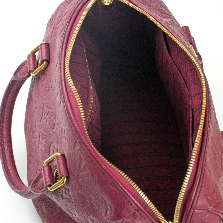 Women's Louis Vuitton, Speedy 25 in burgundy leather For Sale