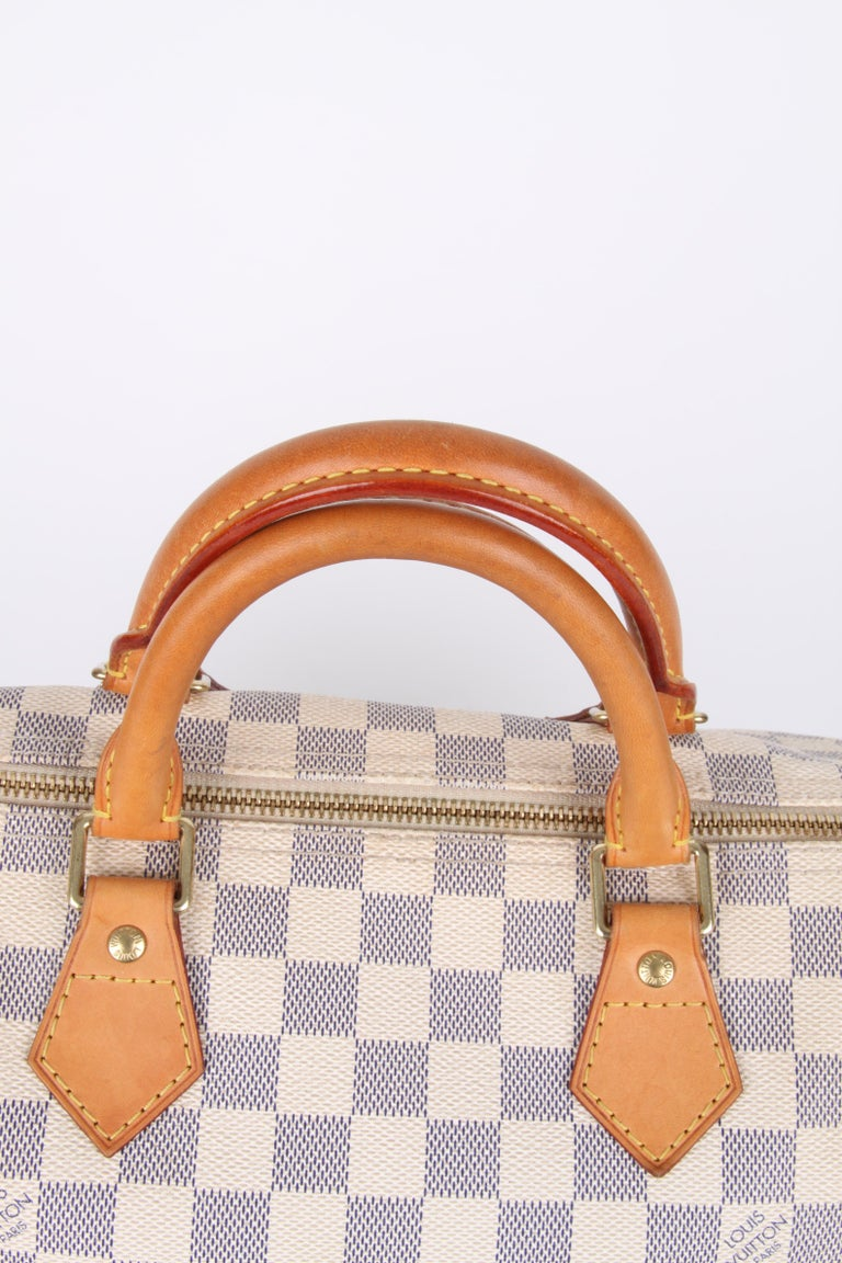 Louis Vuitton Speedy 30 Damier Azur Canvas Bag.  Fashioned from luminous Damier Azur canvas, the Speedy 30 is an elegant, compact handbag, a stylish companion for city life. Launched in 1930 as the