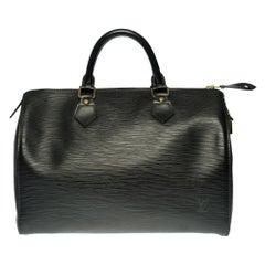 Louis Vuitton Speedy 30 handbag in black épi leather and gold hardware