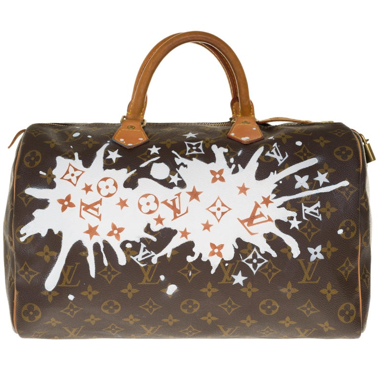 Louis Vuitton Speedy 35 handbag in Monogram canvas customized by the popular artist of Street Art PatBo with his work