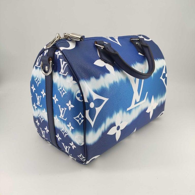 - Designer: LOUIS VUITTON - Model: Speedy Escale - Condition: Never worn.  - Accessories: Dustbag, Box - Measurements: Width: 30cm, Height: 23cm, Depth: 18cm, Strap: 105cm - Exterior Material: Canvas - Exterior Color: Blue - Interior Material: