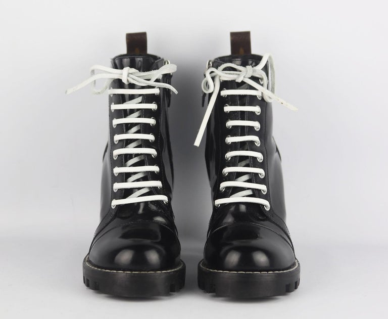 The Star Trail ankle boot, one of Louis Vuitton's most instantly recognisable designs, is interpreted in patent Monogram canvas trim for a truly iconic look, with black leather and white laces.  Heel measures approximately 89 mm/ 3.5 inches with a