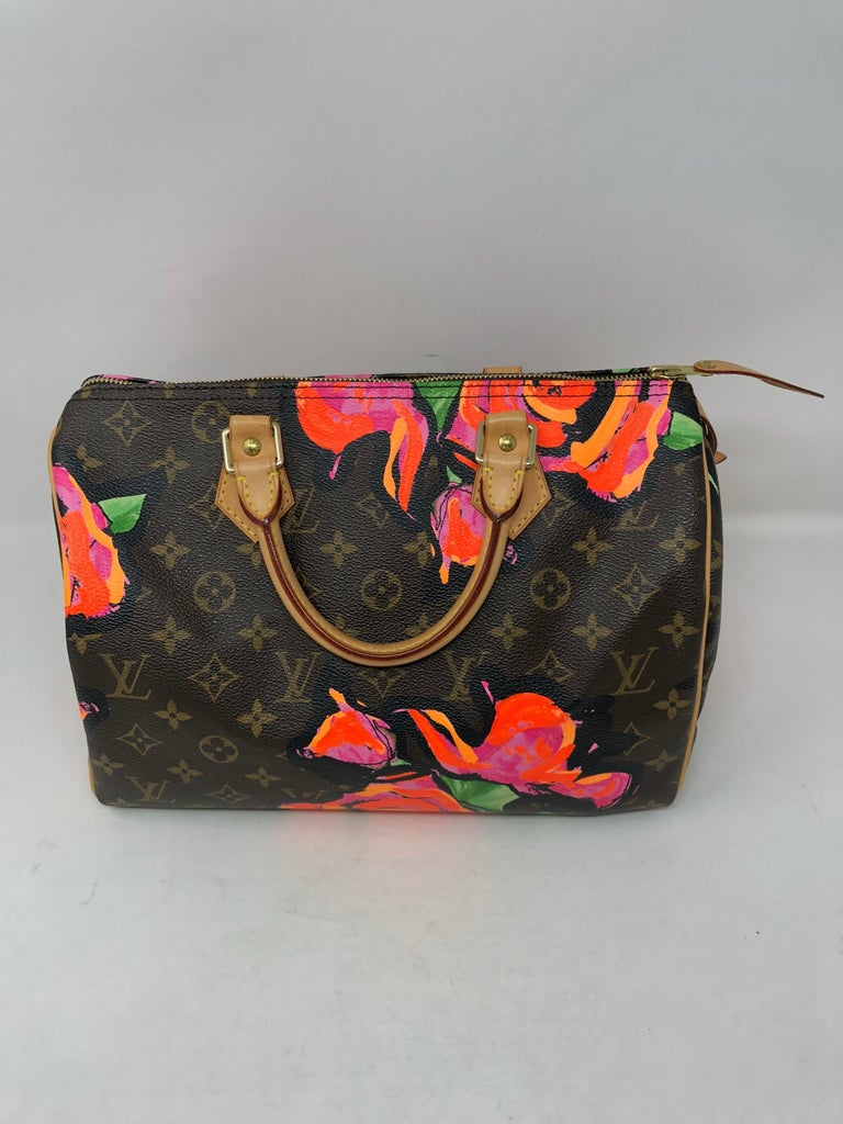 Louis Vuitton Speedy 30 from Stephen Sprouse Roses collection. Rare speedy by iconic designer Stephen Sprouse. Hard to find speedy and in excellent condition. Interior clean too. Guaranteed authentic.
