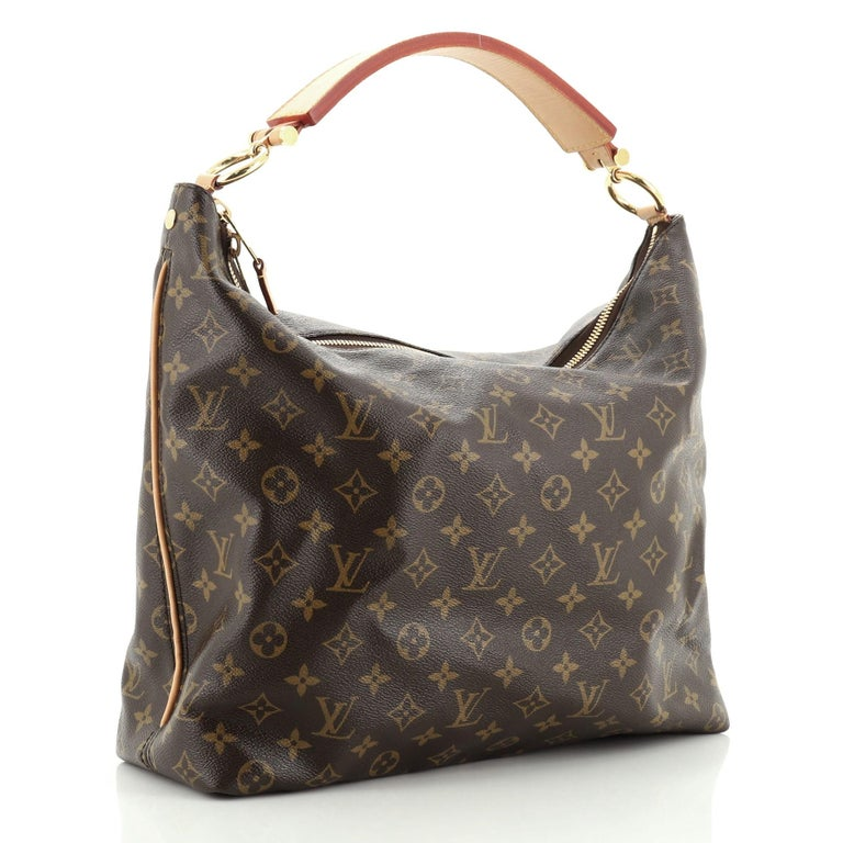 This Louis Vuitton Sully Handbag Monogram Canvas MM, crafted from brown monogram coated canvas, features a thick vachetta cowhide looped strap and gold-tone hardware. Its two-way zip closure opens to a brown fabric interior with slip pockets.