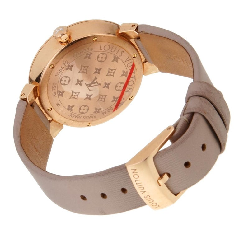 A classic Louis Vuitton Tambour Slim rose gold case set with 60 diamonds, the sculpted mother of pearl monogram flower is set with an additional 58 round brilliant cut diamonds. The bracelet is interchangeable and features the Ardillon buckle in 18k
