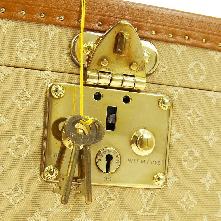 Louis Vuitton Limited Edition Tan Monogram Leather Travel Vanity Top Handle Storage Box Trunk  Fabric Leather Silver tone hardware Flip lock closure Velvet lining Date code present Made in France Handle drop 1.5