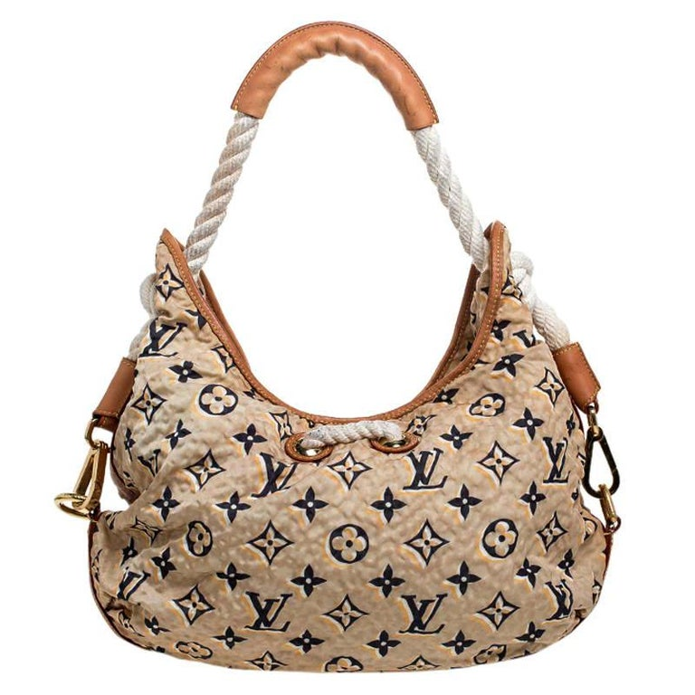 We rarely get to see an available limited edition bag as gorgeous as this one. Every feature on it is awe-evoking which makes the creation all the more worthy of being owned. This Louis Vuitton Bulles bag has been crafted from nylon and lined with