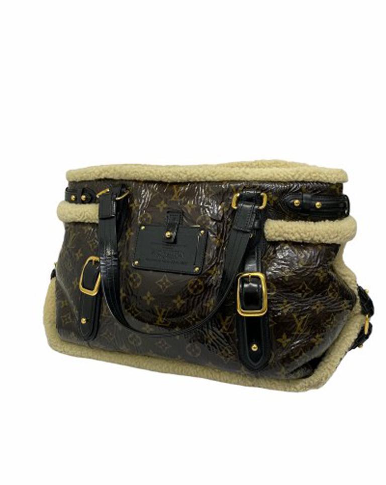 Women's Louis Vuitton Thunder Shearling LE Handbag in Shiny Monogram Leather & Sheepskin For Sale