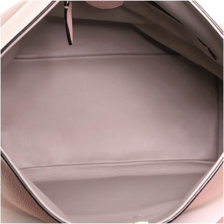 Women's or Men's Louis Vuitton Tournon Handbag Leather For Sale