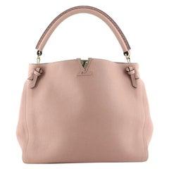 Louis Vuitton Tournon Handbag Leather