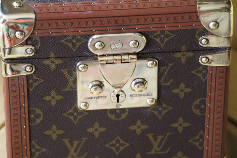 Very nice Louis Vuitton monogram train case with solid brass corners and lock.  Leather top handle.  All its studs are engraved Louis Vuitton.  Its interior is in very good condition too.  H 8.27 in. x W 8.67 in. x D 11.82 in. H 21 cm x W 22 cm x D