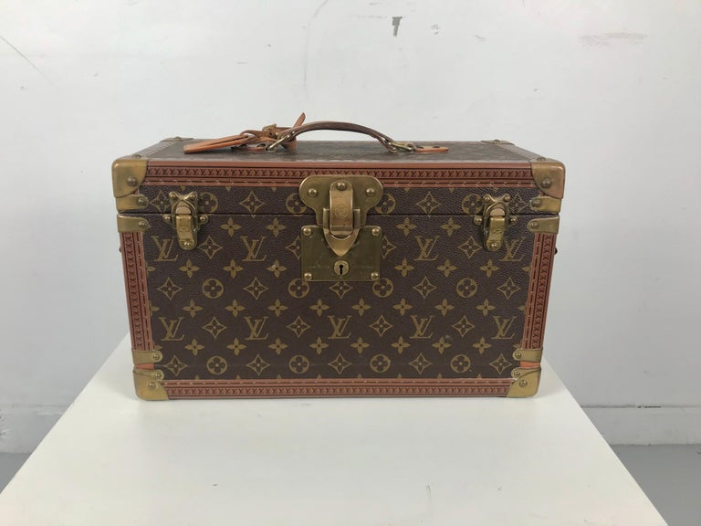 Classic Louis Vuitton Monogramed train case, Vuitton Boite Pharmacie, cosmetic case, I believe this to be 1960s vintage. Unusual (seldom seen) drop front design. Retains interior jewel box. Original key. Case in remarkable original condition.