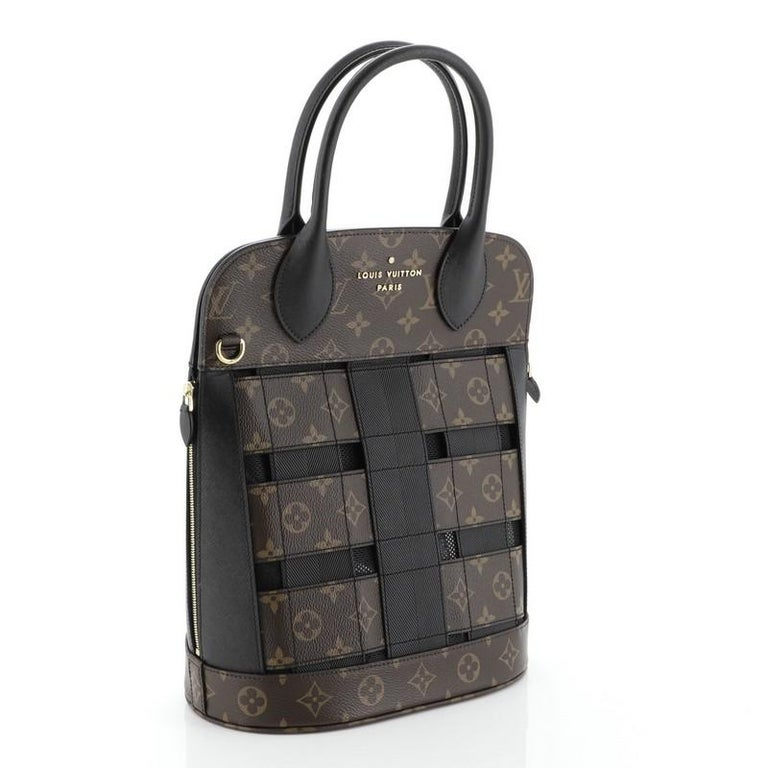 This Louis Vuitton Tressage Tote Monogram MM, crafted in brown monogram coated canvas and black leather, features dual rolled leather handles, leather trim, and gold-tone hardware. It opens to a black fabric interior with zip pocket. Authenticity