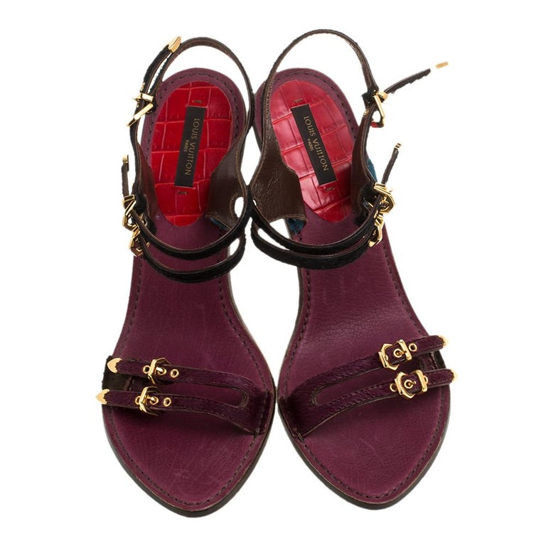 Crafted from luxurious calf hair and croc leather, these stylish and feminine sandals come from Louis Vuitton. They feature open toes and twin buckled straps on the vamps and ankles. The pretty hues add extra style to this lovely pair. The insoles