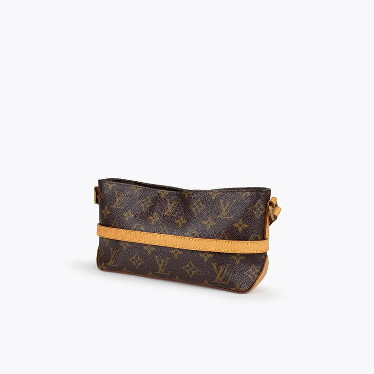 Brown and tan monogram coated canvas Louis Vuitton Trotteur crossbody bag with  - Brass hardware - Single flat shoulder strap - Tan vachetta leather trim - Brown canvas lining, single zip pocket at interior walls and zip closure at top  Overall
