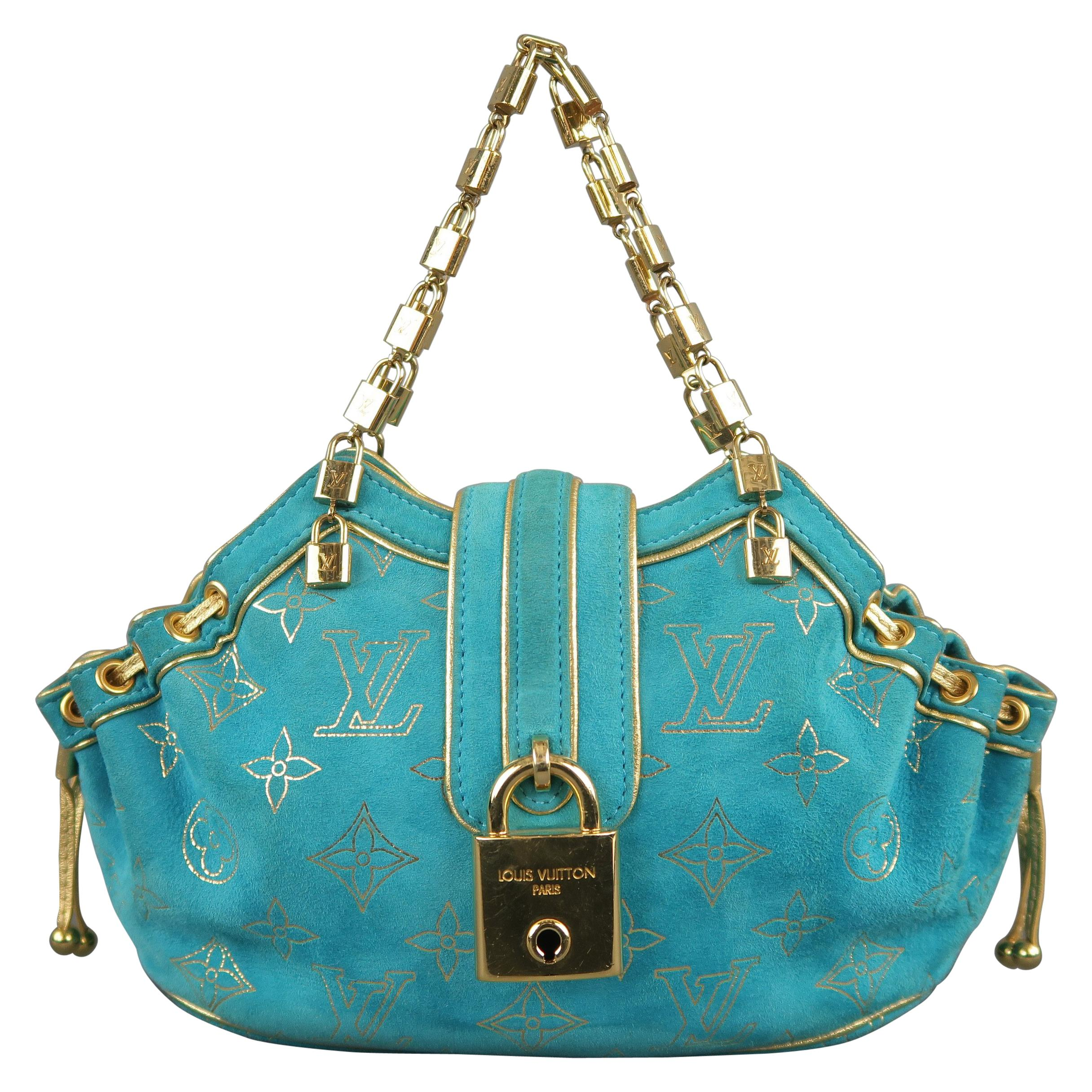 06ea79e867ed LOUIS VUITTON Turquoise and Gold Monogram Suede Lock Chain Strap THEDA PM Mini  Bag For Sale at 1stdibs