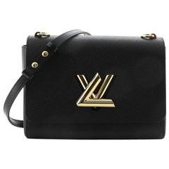 Louis Vuitton Twist and Twisty Handbag Epi Leather MM
