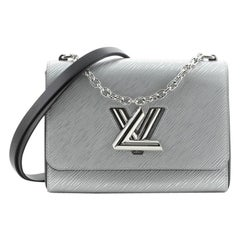 Louis Vuitton Twist Convertible Handbag Epi Leather MM