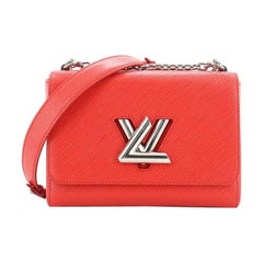 Louis Vuitton Twist Handbag Epi Leather MM