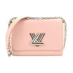 Louis Vuitton Twist Handbag Epi Leather MM