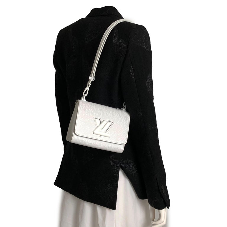 Authentic, new in box Louis Vuitton Twist PM bag in white Epi leather. Currently SOLD OUT online in the US. One chic summer bag! Carry by chain handle or wear as crossbody with strap. Interior lined in microfiber w/one slip pocket with removable