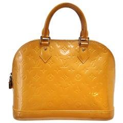 Louis Vuitton Vernis Alma PM Passion Yellow Monogram Hand Bag