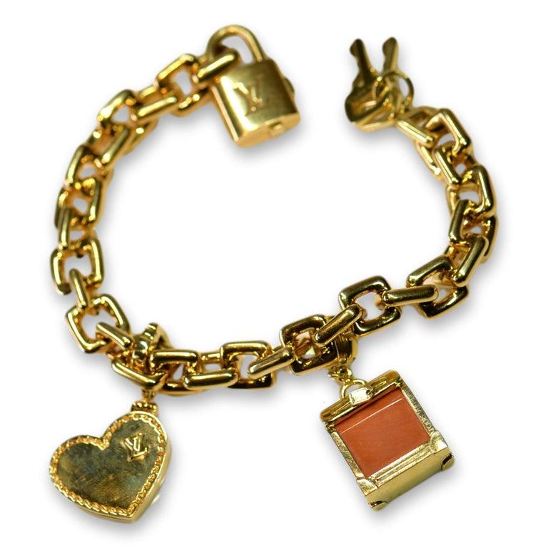 Louis Vuitton Vintage 18 Karat Gold Charm Bracelet with Original Case For Sale 5