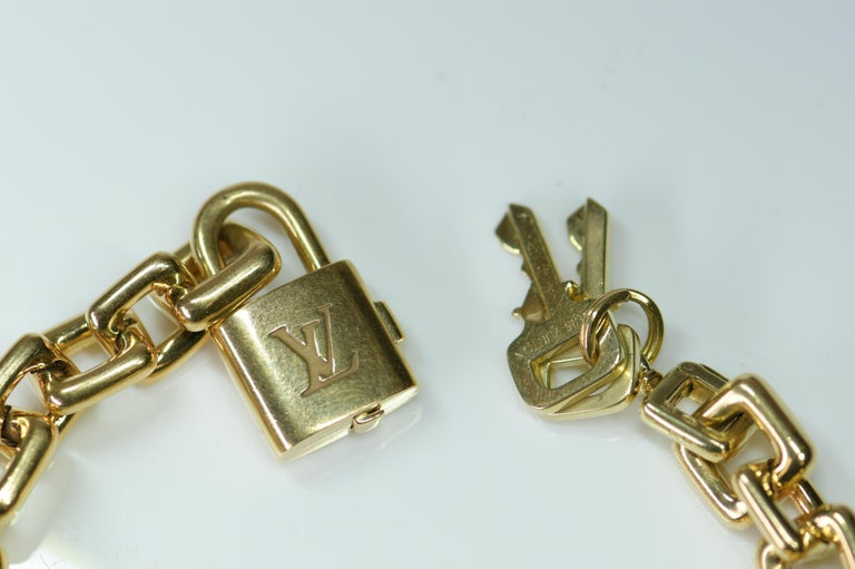 Louis Vuitton Vintage 18 Karat Gold Charm Bracelet with Original Case For Sale 1