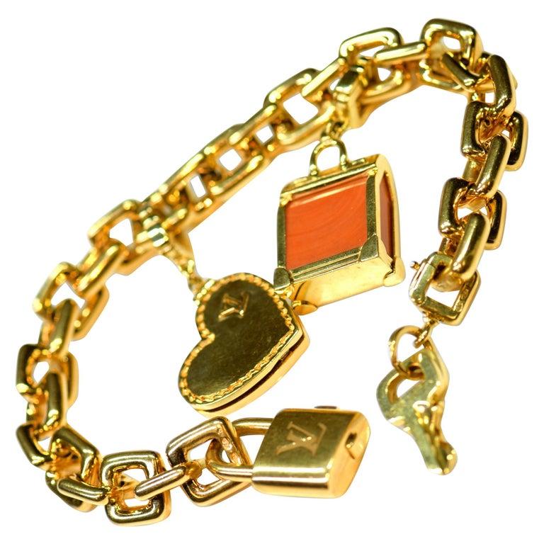Louis Vuitton Vintage 18 Karat Gold Charm Bracelet with Original Case For Sale