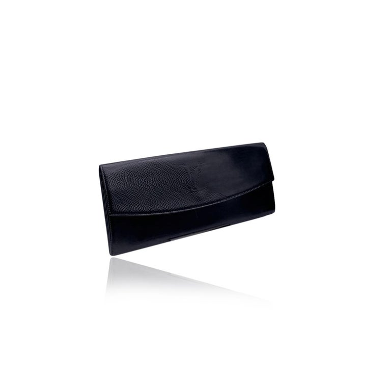 Louis Vuitton vintage black leather Opera Egee clutch. Black Leather, with epi leather detailing on the flap and big LV logo. Flap with button closure on the front, 3 compartments inside. Rear handle. 'LOUIS VUITTON' engraved under the flap. 'Made