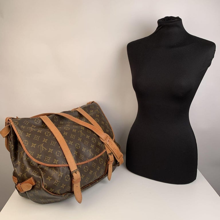 Rare Louis Vuitton Saumur 40 Messenger Bag. The largest model of the Saumur line. Discontinued model, very collectible. Inspired by equestrian 'SADDLE' bag, the legendry SAUMUR 40 features dual front compartments, held tightly together at the sides