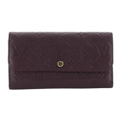 Louis Vuitton Virtuose Wallet Monogram Empreinte Leather