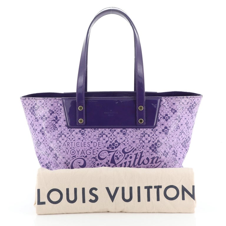 This Louis Vuitton Voyage Tote Cosmic Blossom PM, crafted from purple cosmic blossom leather, features dual flat leather handles, cosmic monogram flower prints, protective base studs and gold-tone hardware. Its hook clasp closure opens to a purple