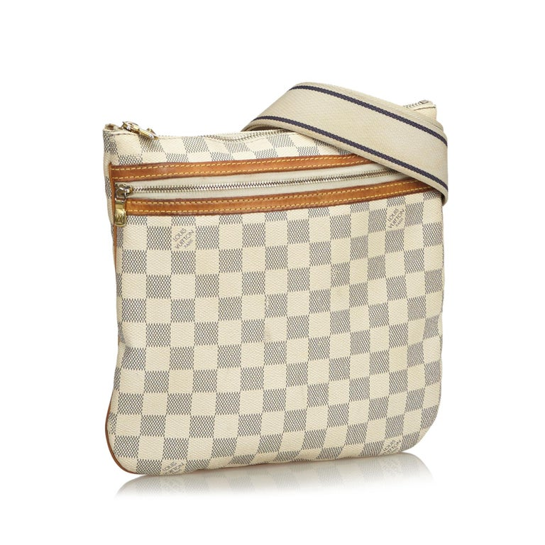 The Pochette Bosphore features a damier azur canvas body with vachetta trim, flat strap, top zip closure, and an exterior zip pocket. It carries as B+ condition rating.  Inclusions:  This item does not come with inclusions.   Louis Vuitton pieces do