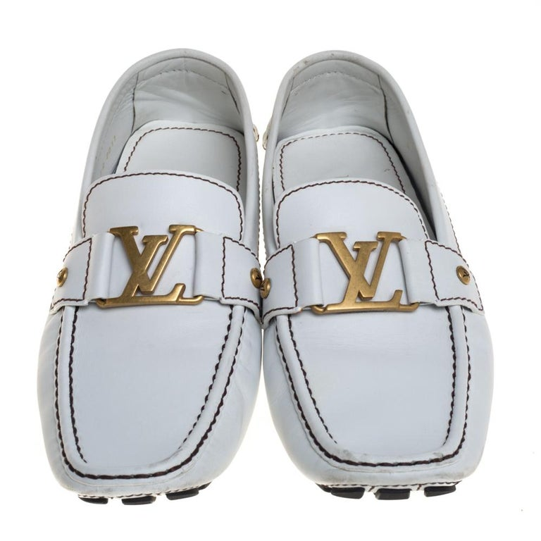 Look sharp and neat with this pair of Monte Carlo loafers from Louis Vuitton. They have been crafted from white leather and designed with the art of fine stitching and the signature 'LV' on the uppers. The pair is complete with comfortable insoles