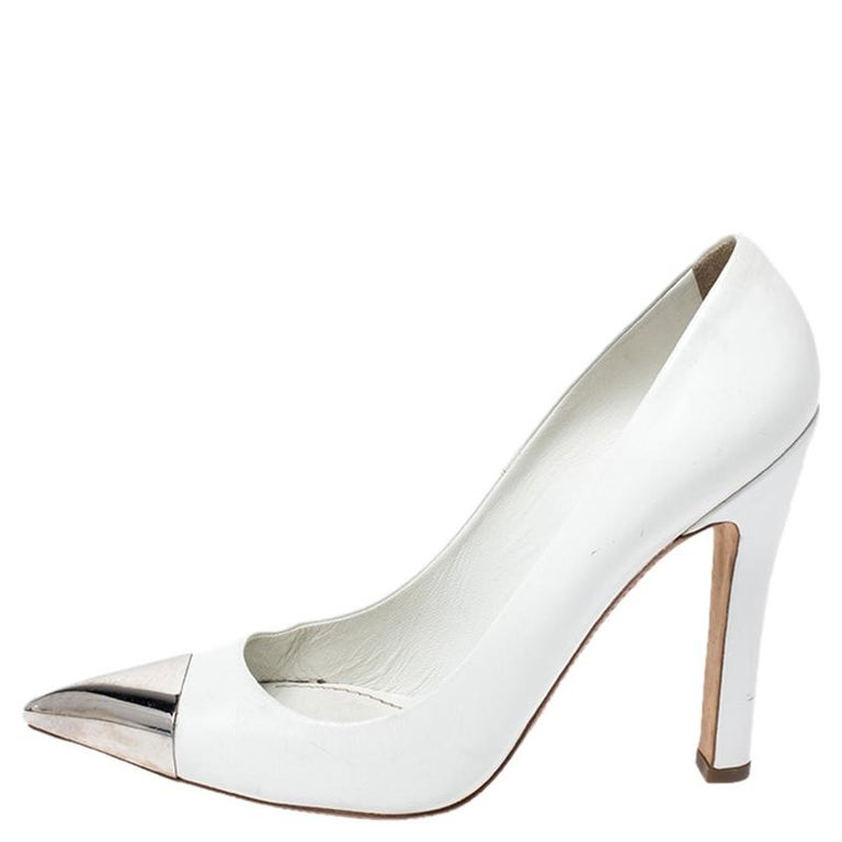 It is every woman's dream to own pumps as appealing as these Louis Vuitton ones. Crafted from leather, they come in a lovely shade of white. They are designed to deliver class and sophistication. They are styled with pointed toes with silver-tone