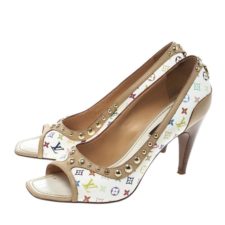 Speak LV in every step with this gorgeous pair of pumps. Made from leather and multicolour monogram canvas, they feature studs, 9 cm heels, peep toes, and comfortable insoles.  Includes: The Luxury Closet Packaging  The Luxury Closet is an elite
