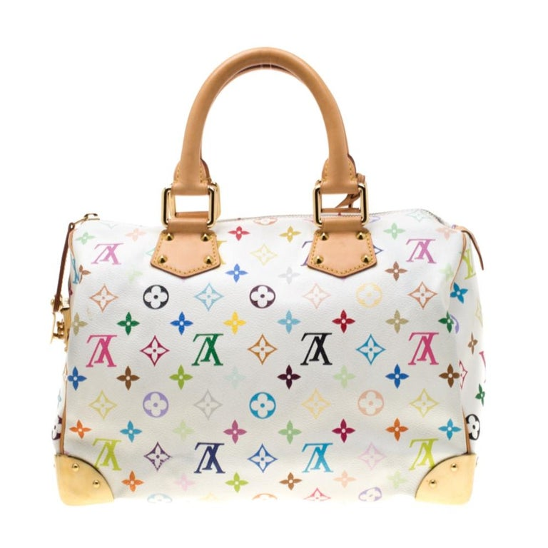 A traditional style that takes you back to the 1960's, Speedy was one of the first bags made by Louis Vuitton for everyday use. White in color the bag is crafted from Louis Vuitton's multicolor Monogram canvas. It has gold tone hardware and enough