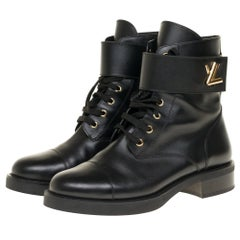 Louis Vuitton Wonderland Rangers in black calf and golden twist clasp