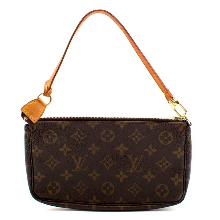Louis Vuitton x Takashi Murakami Pochette Accessoires   This bag is made out of the traditional monogram canvas with the iconic Murakami Cherry design with a vachetta leather trim and strap. It has brown textile lining, a zip top closure and gold