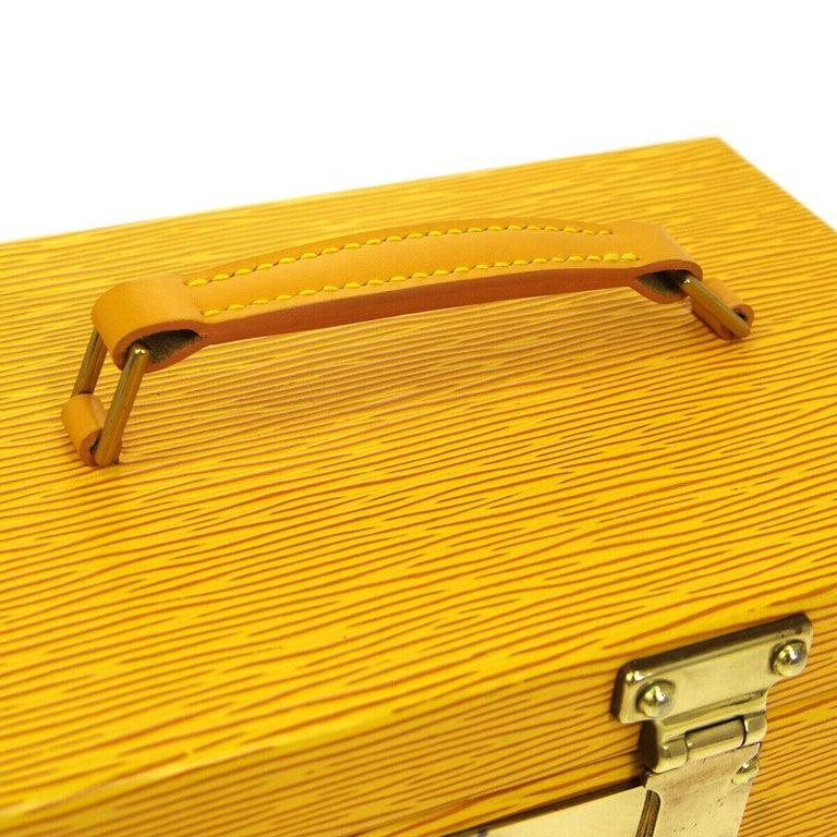 Epi Leather Gold tone hardware Flip lock closure Leather lining Handle drop 1.5