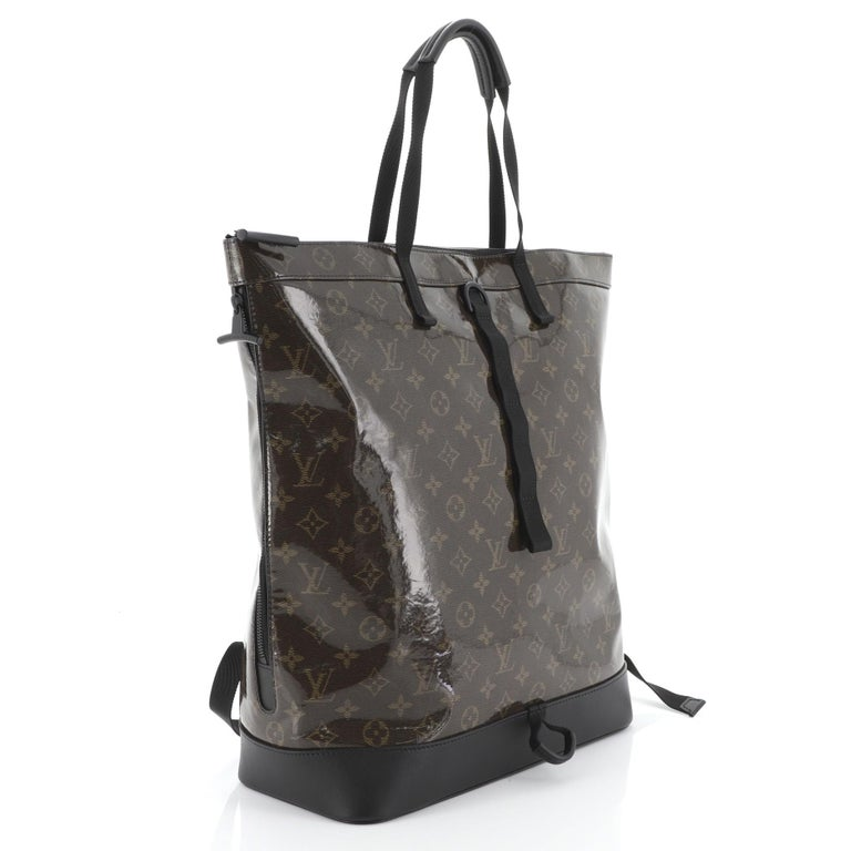 This Louis Vuitton Zipped Tote Limited Edition Monogram Glaze Eclipse Canvas, crafted from brown monogram glaze eclipse canvas, features dual top handles, adjustable backpack straps, exterior side zip pocket, and black-tone hardware. Its zip closure