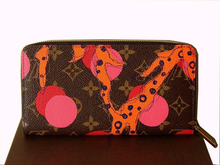 This colorful wallet is from Louis Vuitton's summer 2015 Ramages' collection which was a limited edition.  It measures 7.5 x 3.9 inches and features 8 credit card slots, 1 large zip coin pocket, 3 large gusseted compartments, and 3 flat pockets.