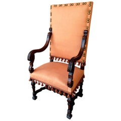 Louis XIII Period Armchair Upholstered in Textured Peach Fabric and Tassels